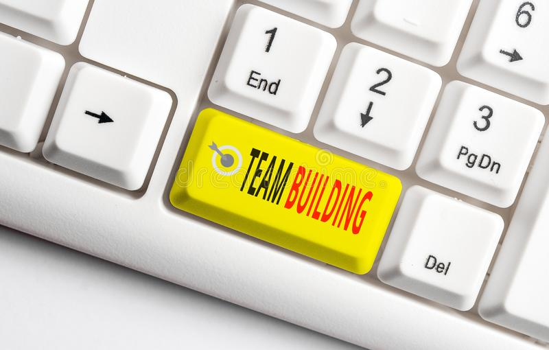 Conceptual hand writing showing Team Building. Business photo showcasing various types of activities used to enhance. Conceptual hand writing showing Team royalty free stock photos