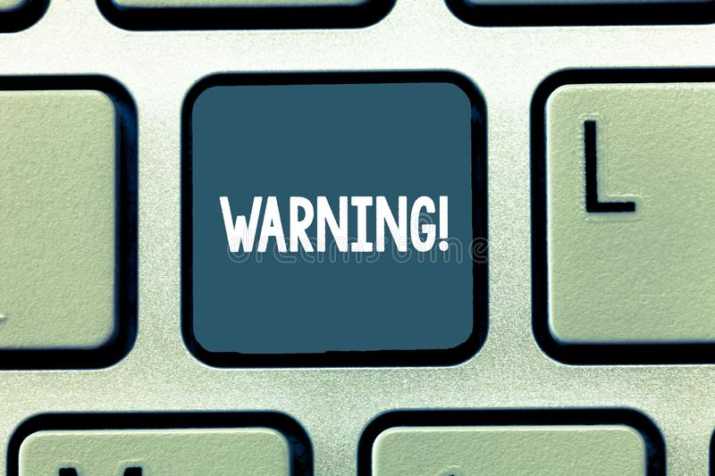 Conceptual hand writing showing Warning. Business photo showcasing statement or event that warns of something or serves. As example Keyboard Intention to create royalty free stock photos