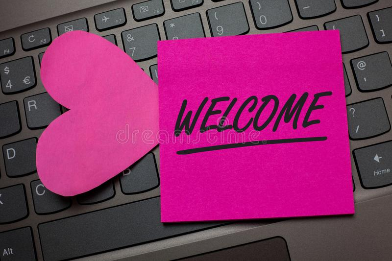 Conceptual hand writing showing Welcome. Business photo text Warm salutation acknowledgement for someone amiable loved thanked Key. Board grey keys pink paper royalty free stock photography
