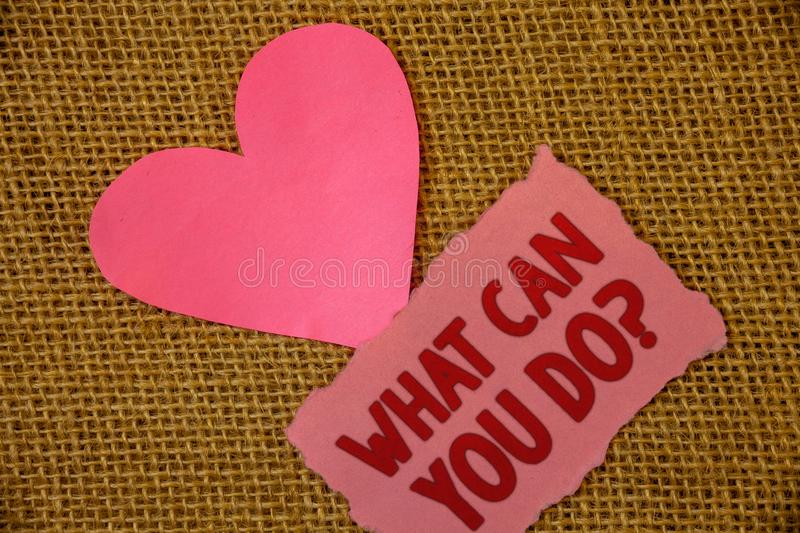 Conceptual hand writing showing What Can You Do Question. Business photo text Service Determination Purpose Worth Contemplation Te. Xt pink torn paper note heart royalty free stock images