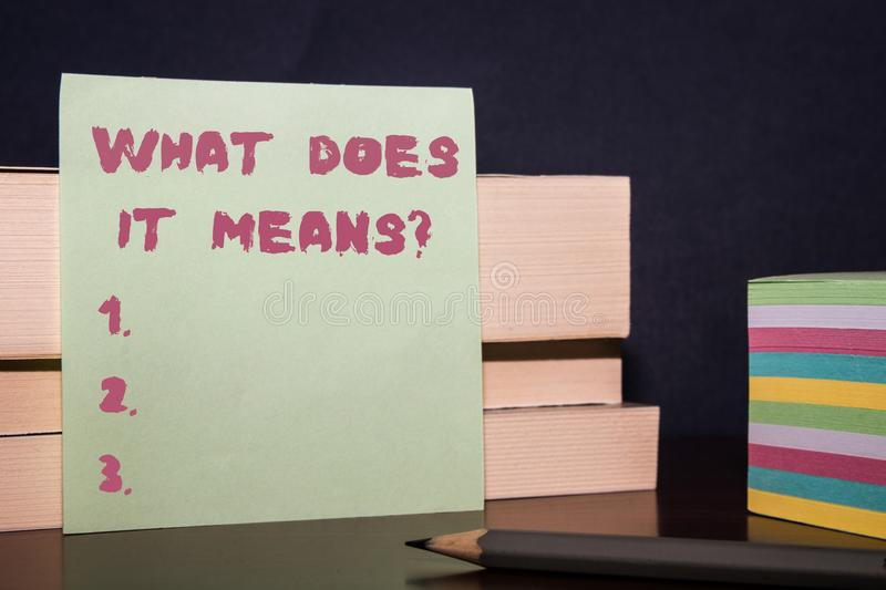 Conceptual hand writing showing What Does It Means question. Business photo showcasing asking meaning something said and stock image