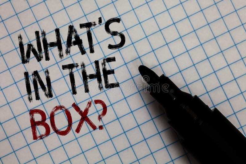 Conceptual hand writing showing What s is In The Box question. Business photo text Curiosity Opening a gift Surprise package Black. Marker square marked white stock photo