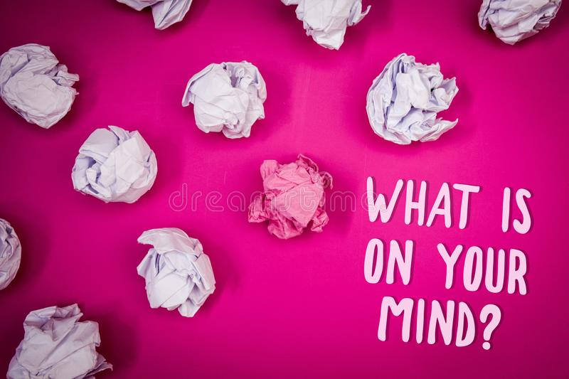 Conceptual hand writing showing What Is On Your Mind Question. Business photo text Open minded thinks of intellectual innovation I. Deas pink background crumpled royalty free stock photography