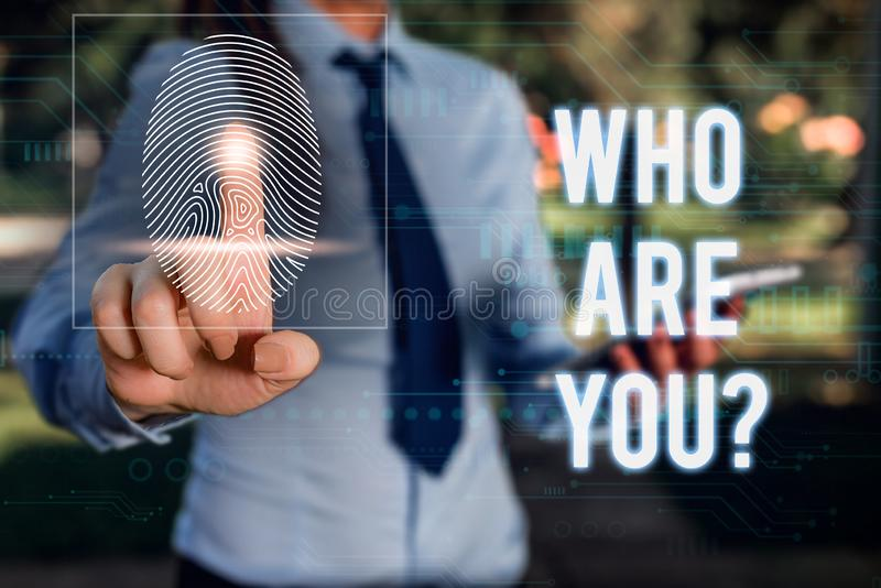 Conceptual hand writing showing Who Are You question. Business photo showcasing asking about demonstrating identity or. Conceptual hand writing showing Who Are royalty free stock photo