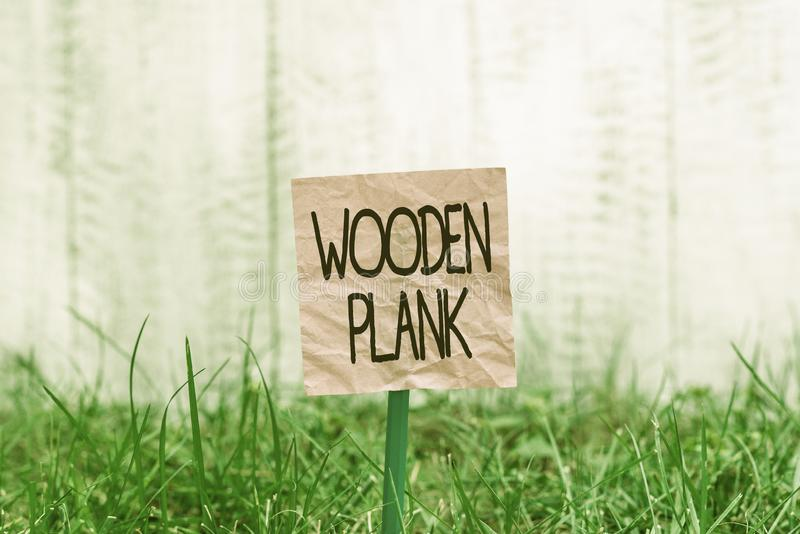 Conceptual hand writing showing Wooden Plank. Business photo text wood or similar material of the type used for making royalty free stock images