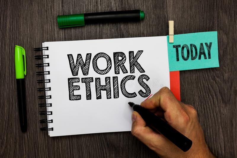 Conceptual hand writing showing Work Ethics. Business photo showcasing A set of values centered on the importance of doing work Ma. N holding marker notebook royalty free stock photos