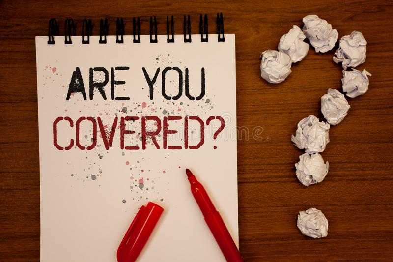 Conceptual hand writing showing Are You Covered Question. Business photo showcasing Have a Security and Health Insurance Medical C. Are Ideas on notebook wooden stock photo