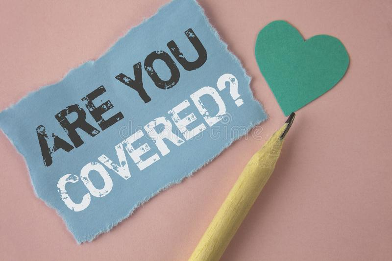 Conceptual hand writing showing Are You Covered Question. Business photo showcasing Health insurance coverage disaster recovery wr stock image
