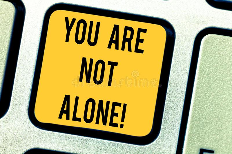 Conceptual hand writing showing You Are Not Alone. Business photo text Offering help support assistance collaboration royalty free stock photos