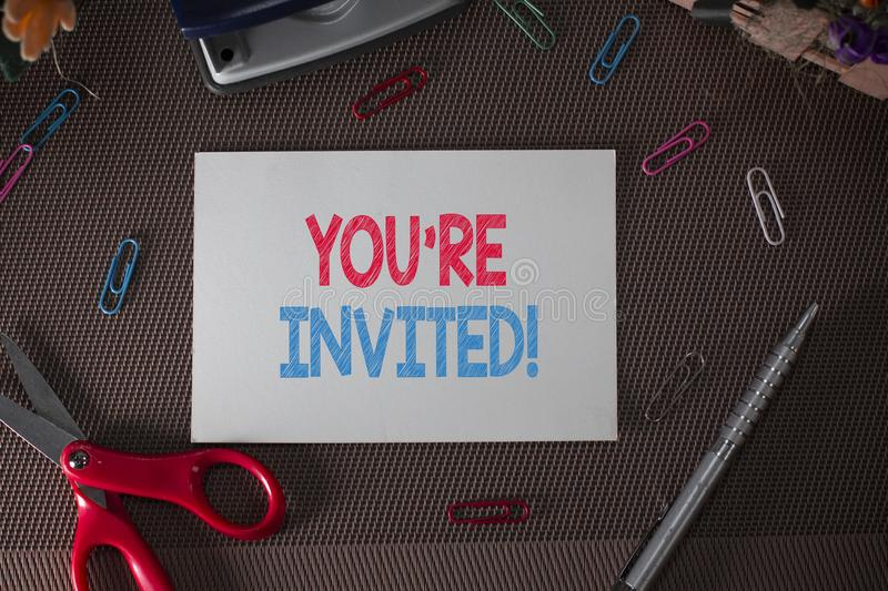 Conceptual hand writing showing You Re Invited. Business photo text make a polite friendly request to someone go. Conceptual hand writing showing You Re Invited stock photos