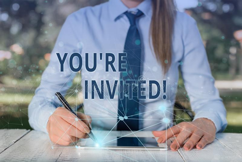 Conceptual hand writing showing You Re Invited. Business photo showcasing make a polite friendly request to someone go. Conceptual hand writing showing You Re stock image