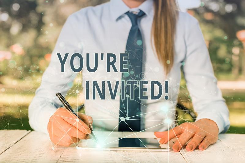 Conceptual hand writing showing You Re Invited. Business photo showcasing make a polite friendly request to someone go. Conceptual hand writing showing You Re stock photography