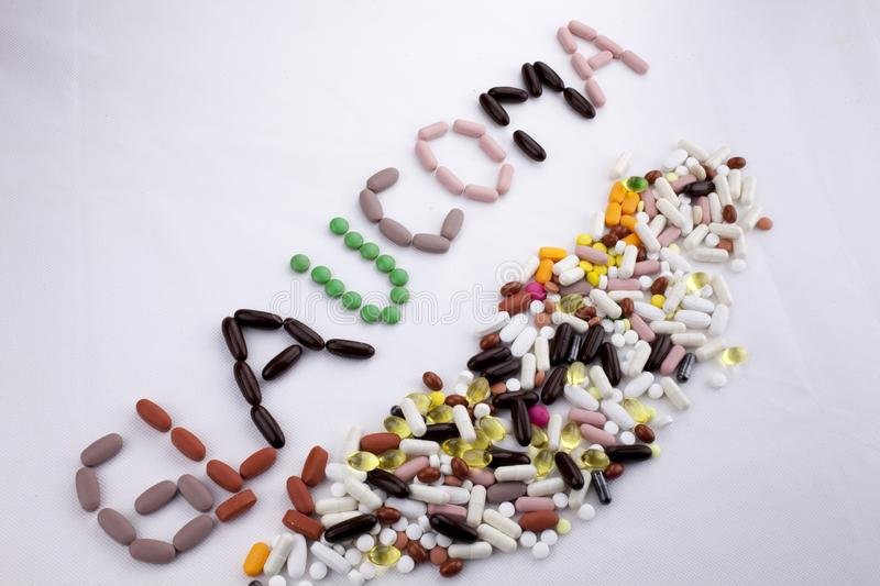 Conceptual Hand writing text caption inspiration Medical care Health concept written with pills drugs capsule word. Glaucoma On white isolated background with stock image