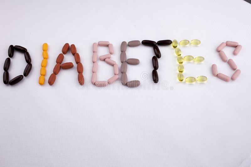 Conceptual Hand writing text caption inspiration Medical care Health concept written with pills drugs capsule word. Diabetes On white isolated background with stock photo