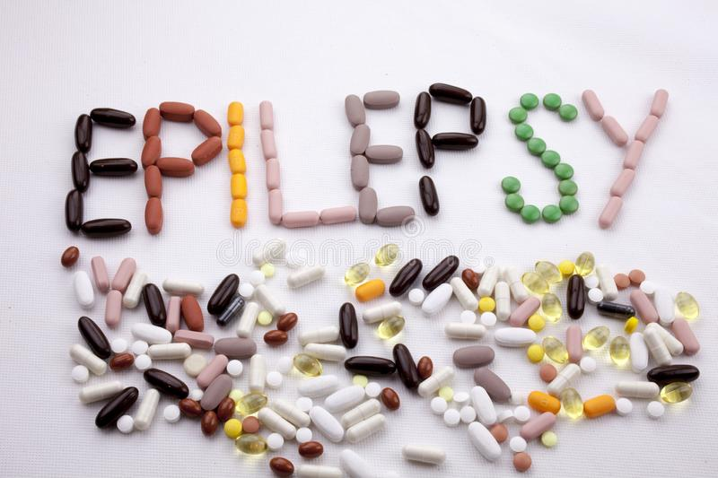 Conceptual Hand writing text caption inspiration Medical care Health concept written with pills drugs capsule word. Epilepsy On white isolated background with stock image