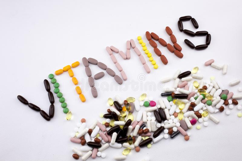 Conceptual Hand writing text caption inspiration Medical care Health concept written with pills drugs capsule word. Vitamins On white isolated background with stock photography
