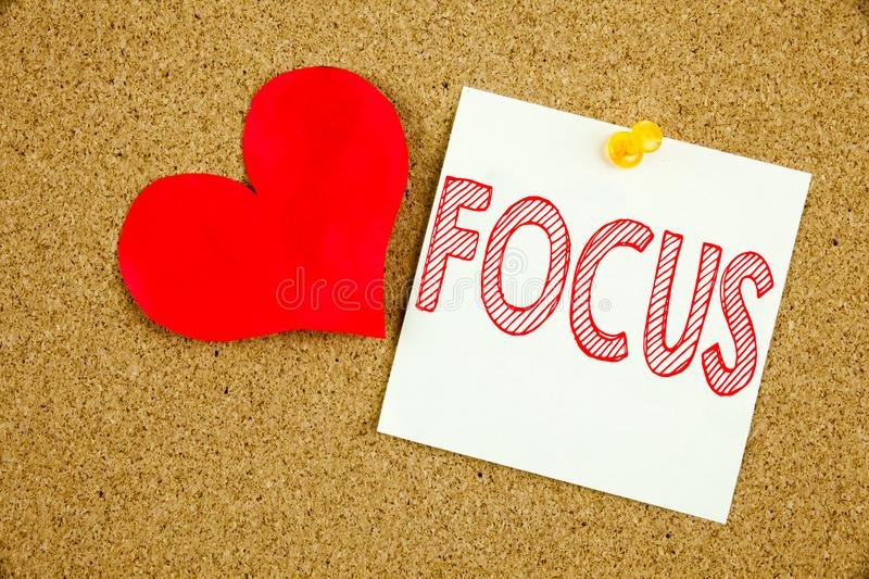 Conceptual hand writing text caption inspiration showing Focus concept for Attention Success Concentrate and Love written on stick stock illustration