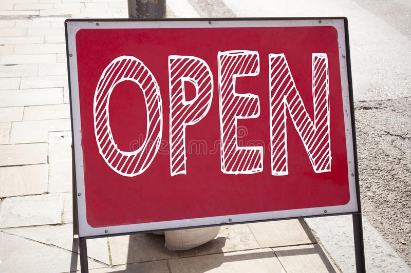 Conceptual hand writing text caption inspiration showing Open. Business concept for shop Opening written on announcement road sign stock photo