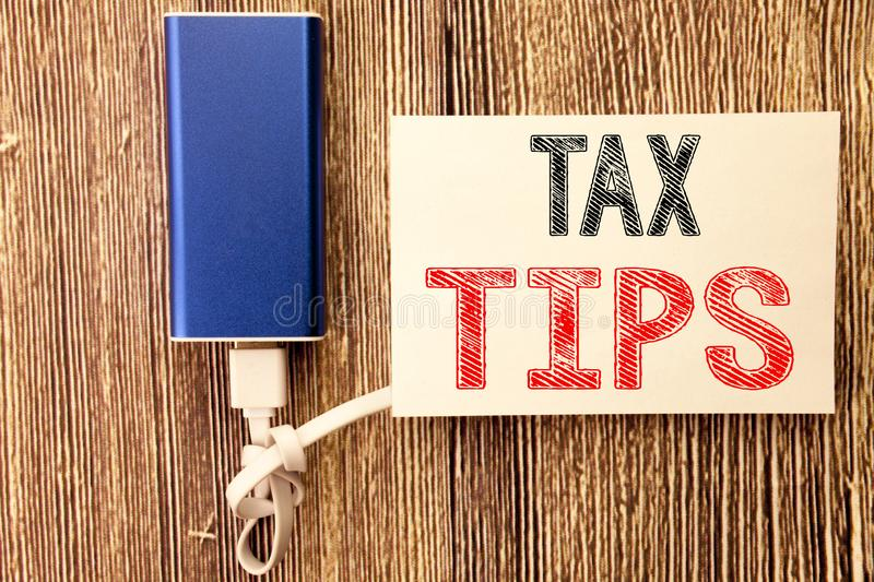 Conceptual hand writing text caption inspiration showing Tax Tips. Business concept for Taxpayer Assistance Refund Reimbursement w. Ritten on sticky note wood stock photo