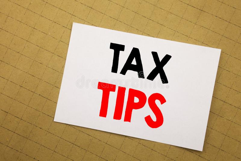 Conceptual hand writing text caption inspiration showing Tax Tips. Business concept for Taxpayer Assistance Refund Reimbursement W. Ritten on sticky note yellow stock photography