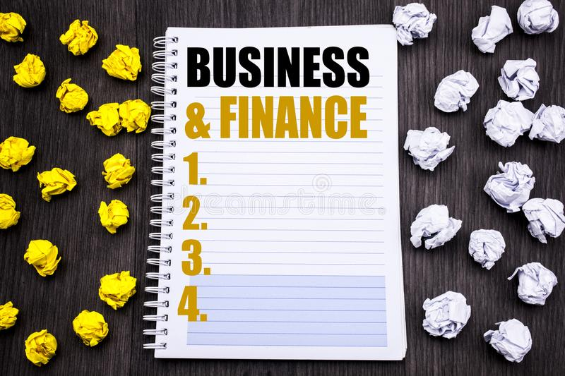Conceptual hand writing text caption showing Business And Finance. Business concept for Company Strategy Written on notepad note n royalty free stock photo