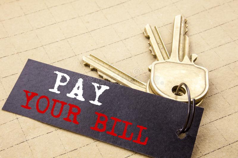 Conceptual hand writing text caption showing Pay Your Bill. Business concept for Payment for Goverment written on note paper attac royalty free stock photo