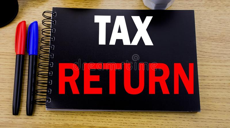 Conceptual hand writing text caption showing Tax Return. Business concept for Accounting Money Return written on sticky note with. Copy space on wood wooden stock images