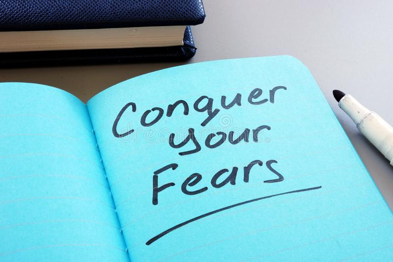 Conceptual hand writing text showing Conquer your fears stock photos