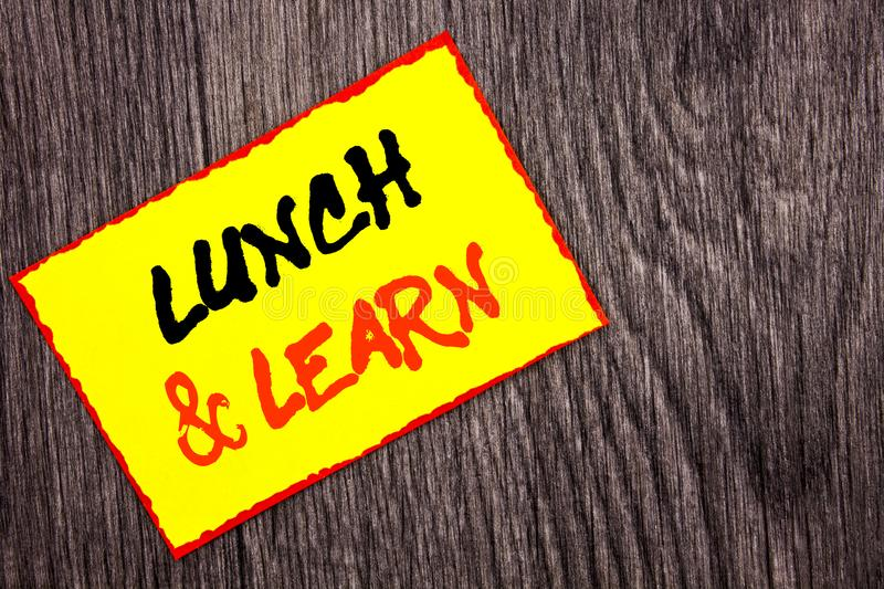 Conceptual hand writing text showing Lunch And Learn. Concept meaning Presentation Training Board Course written on Yellow Sticky. Conceptual hand writing text stock photos