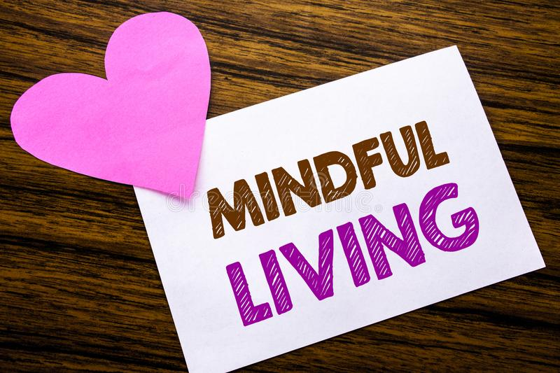 Conceptual hand writing text showing Mindful Living. Concept for Life Happy Awareness written on sticky note paper, wooden wood ba stock photography