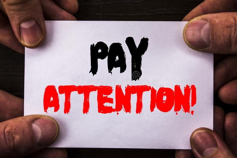 Conceptual hand writing text showing Pay Attention. Concept meaning Be Careful Beware Mindful Alarm written on Sticky Note Paper H. Conceptual hand writing text stock photo