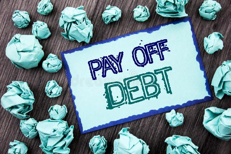 Conceptual hand writing text showing Pay Off Debt. Concept meaning Reminder To Paying Owed Financial Credit Loan Bills written on. Conceptual hand writing text royalty free stock photo