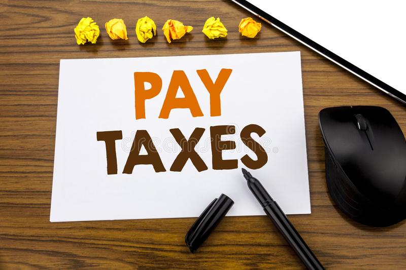 Conceptual hand writing text showing Pay Taxes. Business concept for Taxation Overtax Return written on sticky note paper on the w. Conceptual hand writing text stock photography