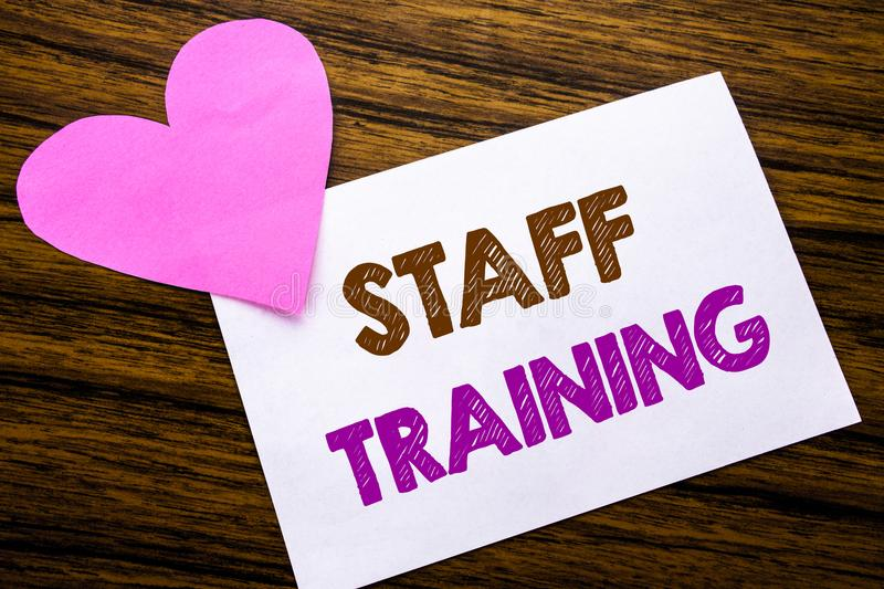 Conceptual hand writing text showing Staff Training. Concept for Teaching or Education written on sticky note paper, wooden wood b stock photo