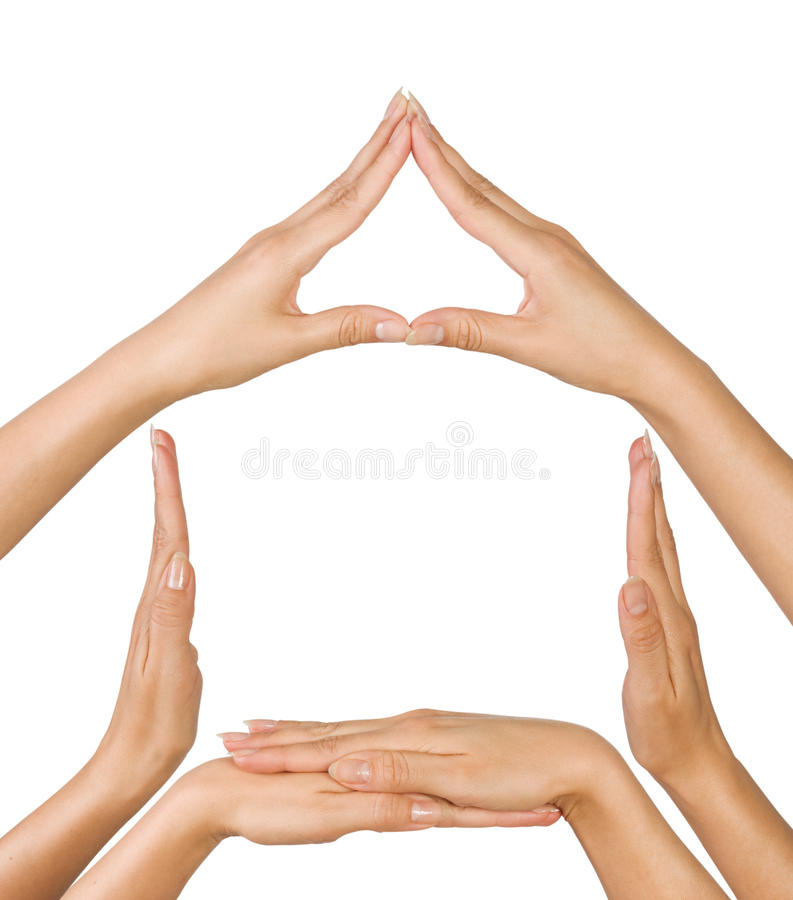 Conceptual home symbol. Female hands showing Conceptual home symbol isolated on white background royalty free stock images