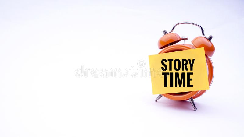 Conceptual image of Business Concept with words Story Time on a clock with a white background. Selective focus. Conceptual image of Business Concept with words stock image