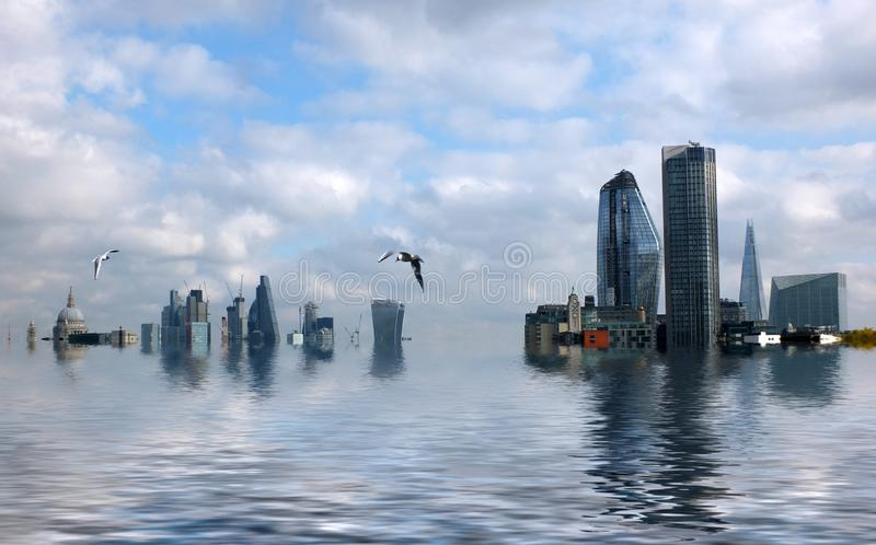 Conceptual image of the city of london with buildings flooded due to global warming and rising sea levels and gulls. Manipulated conceptual image of the city of royalty free stock image