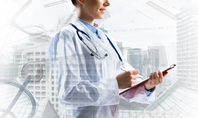 Modern medical industry concept. Conceptual image of confident medical industry employee writing in notebook with city view and medical equipment on background stock illustration