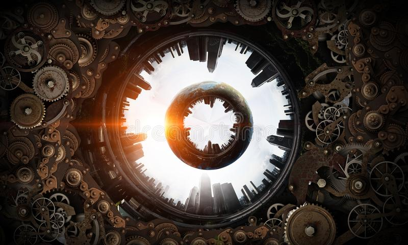 Metal gear mechanism. Mixed media. Conceptual image of construction and production with gears and cogwheels. Elements of this image are furnished by NASA royalty free stock photography