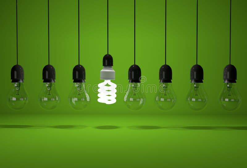 Conceptual image of glowing energy saving bulb and old dark bulb stock photo