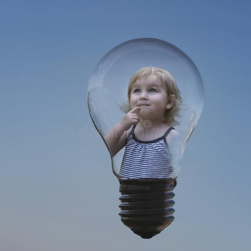 Conceptual image of the idea that has come, a little sweet girl royalty free stock images