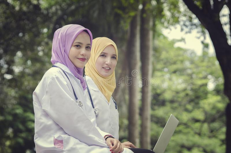 Conceptual image of medical muslimah doctors having a rest royalty free stock images