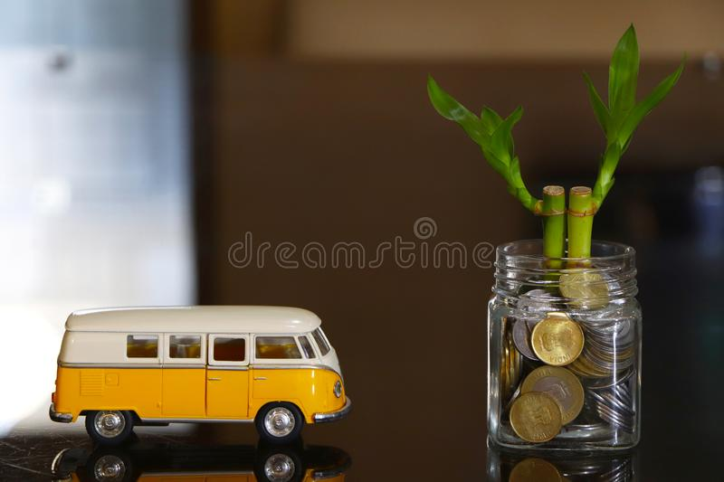 Money plant with vintage car model. Conceptual image of money plant with vintage car model. savings travel loan stock photo