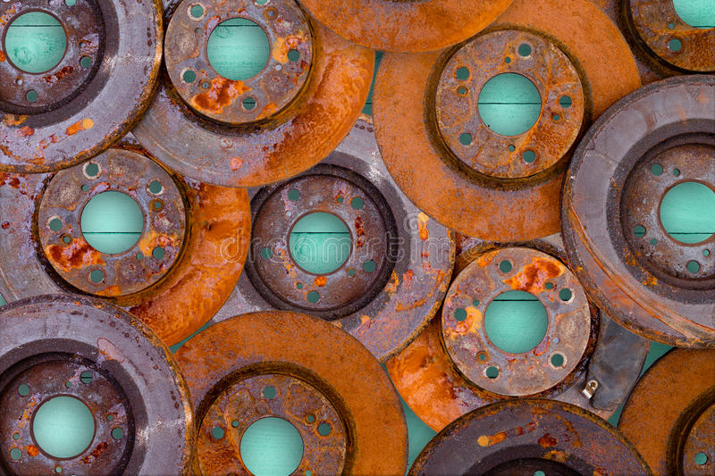 Conceptual image of overlaid rusty brake rotors. Conceptual image of overlaid old weathered rusty and corroded brake rotors from a motor car in a full frame view stock photography