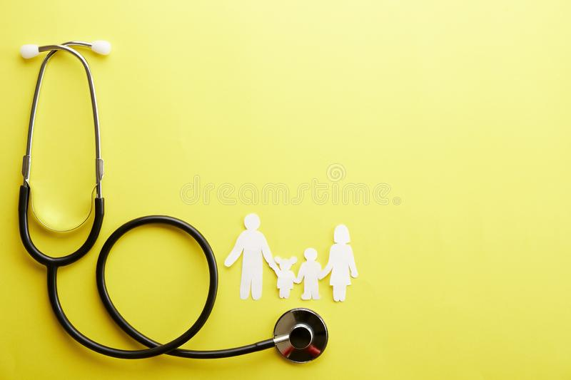 Conceptual image of paper chain in form of family. health insuarance accessories. Family health / life insurance concept. Paper chain in form of family, mother royalty free stock photography