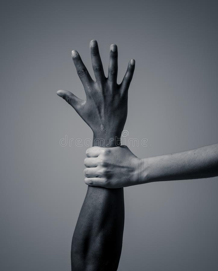 Conceptual image of people of different races together against racism and united for human rights royalty free stock images