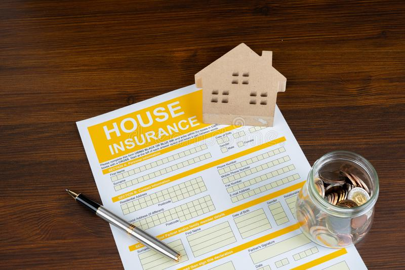 A conceptual image of a scale house and mortgage forms for the people buying a house. Dealing contract royalty free stock photography