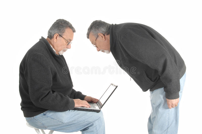 Conceptual image of a senior with laptop stock photography