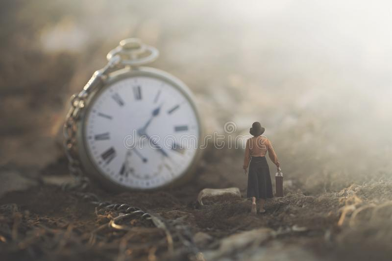 Conceptual image of a small business woman running against the clock stock photo