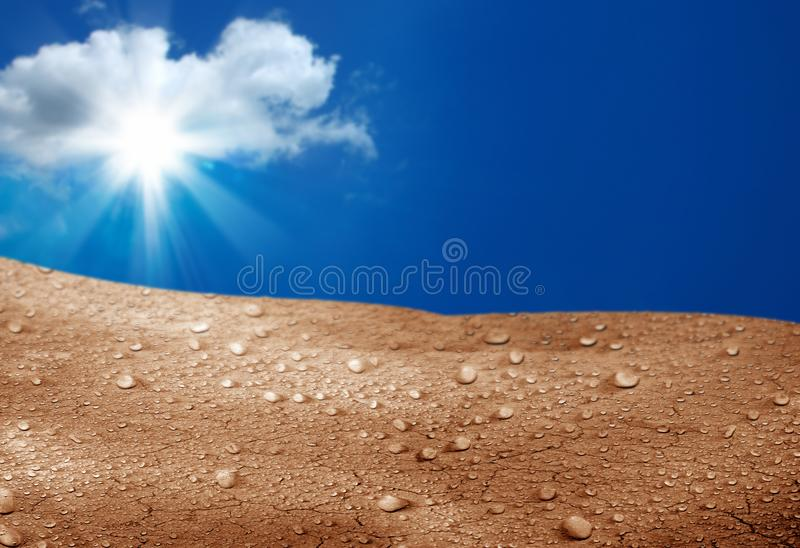 Blue sky and cracked soil. Conceptual image of sunny blue sky and cracked soil stock photography